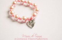 Little Girl's Pink Pearl Stretch Bracelet, Heart with Holy Cross